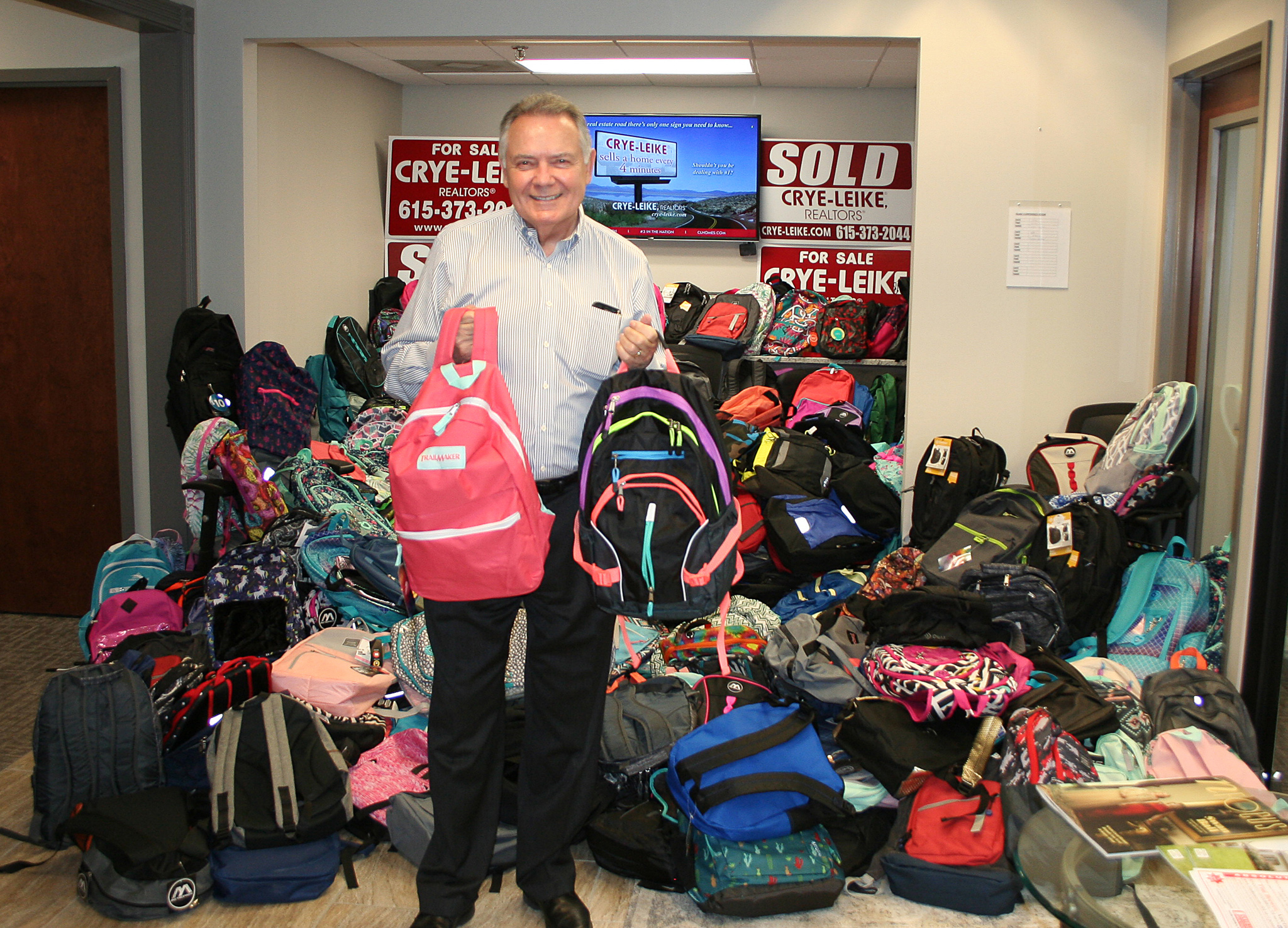 Crye-Leike Real Estate donates 494 backpacks to nonprofit for troubled students