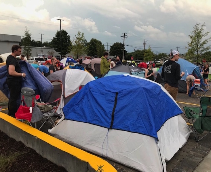Participants in Chick-fil-A promotion take to the parking lot for a night of camping, fun