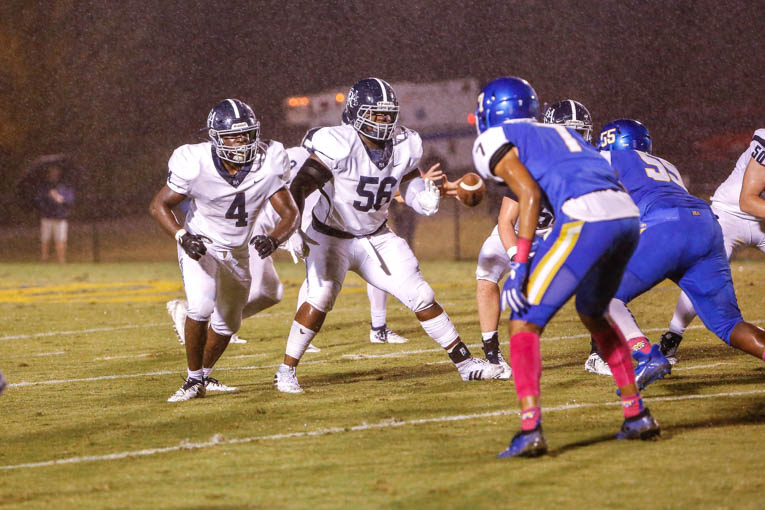 FRA football hangs on for tough, rainy win at BGA