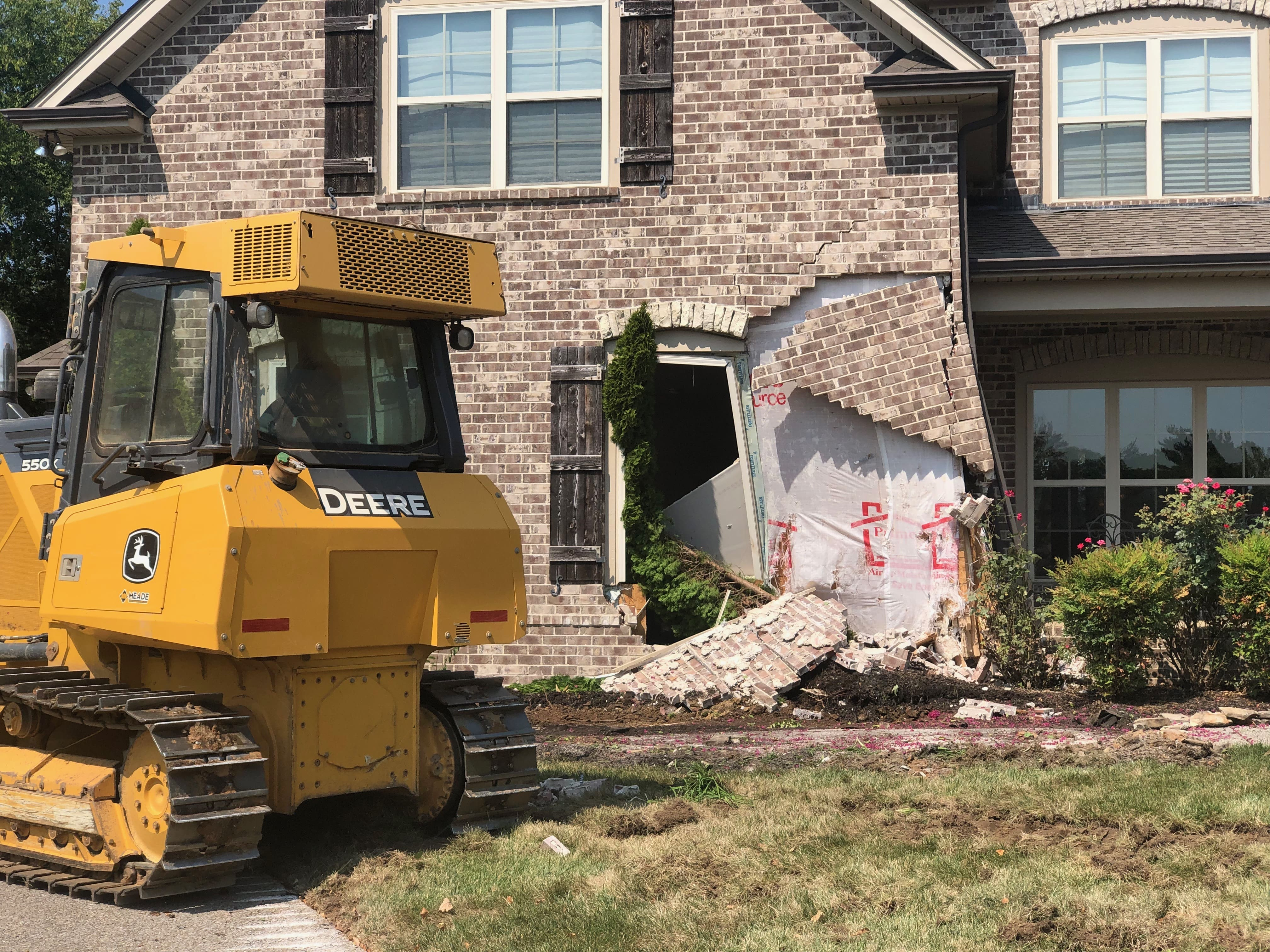 Rogue construction worker takes bulldozer to occupied Spring Hill home